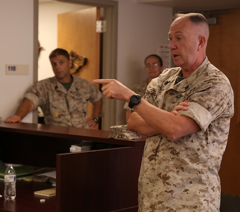 Master Chief Petty Officer Frank Johnson, the command master chief of II Marine Expeditionary Force, addresses sailors with the Ground Combat Element Integrated Task Force during a command visit at the GCEITF battalion aid station, Sept. 11, 2014. Johnson answered questions the sailors had about Navy operations and topics. From October 2014 to July 2015, the Ground Combat Element Integrated Task Force will conduct individual and collective level skills training in designated ground combat arms occupational specialties in order to facilitate the standards based assessment of the physical performance of Marines in a simulated operating environment performing specific ground combat arms tasks. (Official Marine Corps photo by Cpl. Paul S. Martinez/Released)
