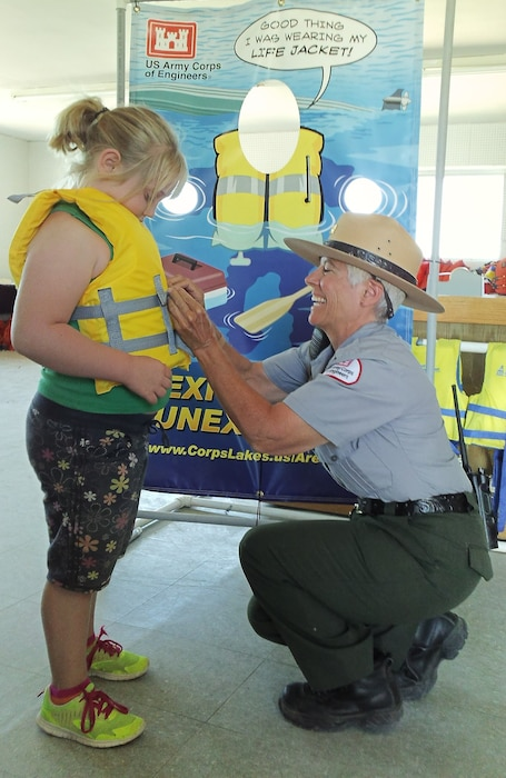CONCHAS DAM, N.M. -- Park Ranger Valerie Mavis adjusts a girl's life jacket to ensure a proper fit, Aug. 31, 2014.