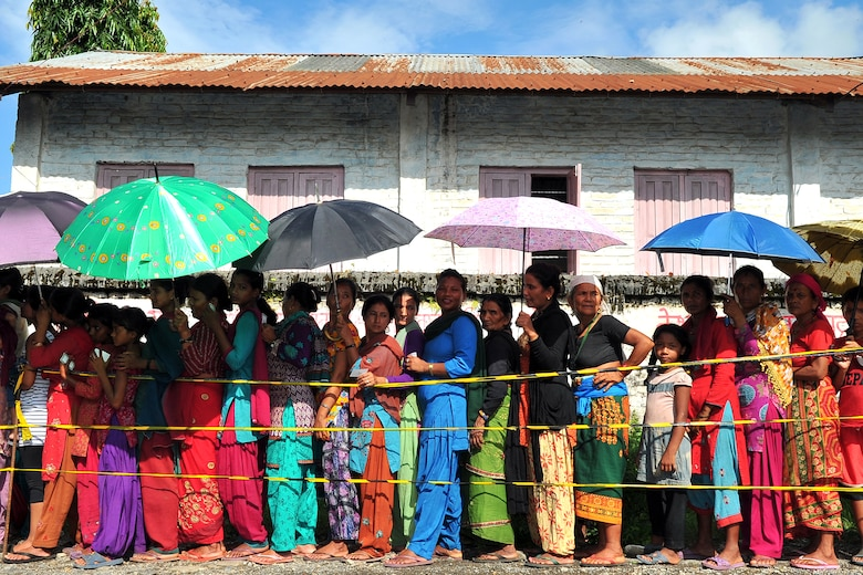 Nepalese women and children wait outside the gate to be seen by Operation Pacific Angel-Nepal medical providers at a health services outreach site in Shaktikhor, Nepal, Sept. 12, 2014. PACANGEL supports U.S. Pacific Command's capacity-building efforts by partnering with other governments, non-governmental agencies and multilateral militaries in the respective region to provide medical, dental, optometry and engineering assistance to their citizens. (U.S. Air Force photo by Staff Sgt. Melissa B. White/Released)