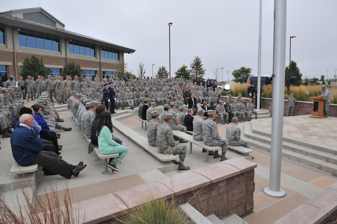 Col. John Wagner, 460th Space Wing commander, speaks during the Patriot Day retreat ceremony Sept. 11, 2014, on Buckley Air Force Base, Colo. Patriot Day is the national day of service and remembrance, in memory of the thousands killed on U.S. soil in the 9/11 attacks. (U.S. Air Force Photo by Airman Emily E. Amyotte/Released)