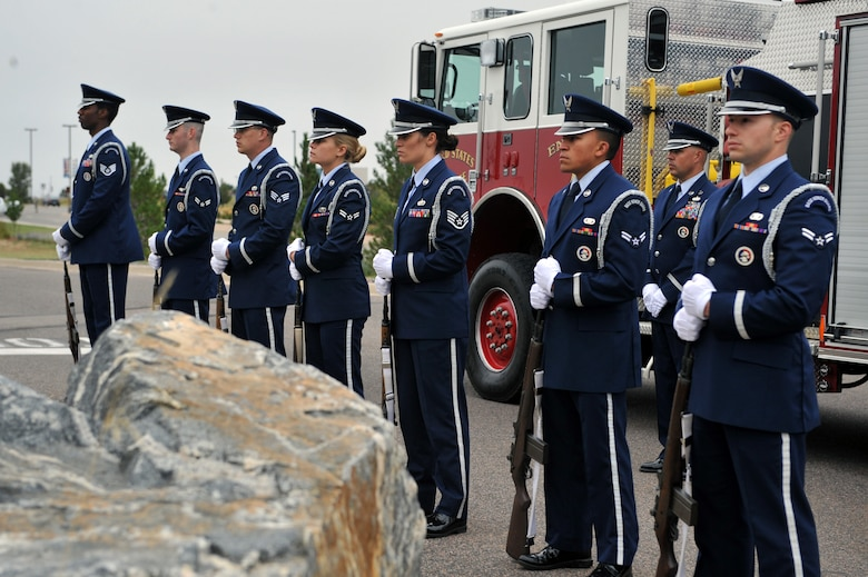 The Mile High Honor Guard stands in honor of the victims and fallen heroes of 9/11 during the Patriot Day retreat ceremony Sept. 11, 2014, on Buckley Air Force Base, Colo. Patriot Day is the national day of service and remembrance, in memory of the thousands killed on U.S. soil in the 9/11 attacks. (U.S. Air Force Photo by Airman Emily E. Amyotte/Released)