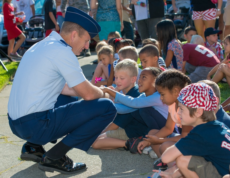 Col. Corey Martin, 60th Air Mobility Wing commander, speaks with children from the Travis Unified School District attending the Freedom Walk ceremony Sept. 11, 2014, at Travis Air Force Base, Calif. (U.S. Air Force photo by Heide Couch)