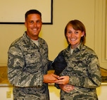 172d Airlift Wing Senior Airmen Jennifer Warren was recently recognized as the wing's Diamond Sharp award winner.  Warren, who works in the 172d Finance Squadron as an account liaison officer, was presented the award on September 6, 2014 by Senior Master Sgt John Myers.  (Air National Guard photo by Tech. Sgt. Marvin B. Moore)