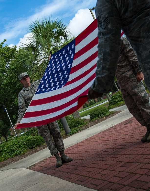 Airmen fold the American flag during a 9/11 memorial retreat ceremony in remembrance of the 9/11 attacks, Sep. 11, 2014, at Joint Base Charleston, S.C. The retreat ceremony was a poignant reminder of the events of 13 years ago, and the continuing efforts today's military is making against the War on Terrorism. (U.S. Air Force photo/Airman 1st Class Clayton Cupit)