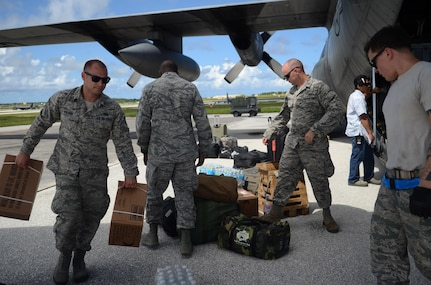 Airmen from the 36th Contingency Response Group load equipment into a C-130 Hercules before departing to support Operation Damayan in Tacloban, Philippines, Nov. 14, 2013, at Andersen Air Force Base, Guam. (U.S. Air Force photo by Airman Marianique Santos )