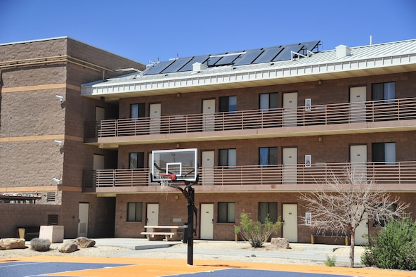 A solar array panel stands on a dormitory roof Sept. 3 at Luke Air Force Base. There are currently four active solar arrays on base. The solar array shown will produce hot water to the dormitory. (U.S. Air Force photo/Senior Airman Grace Lee)
