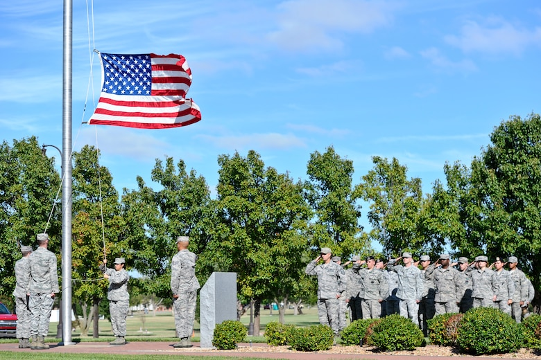 Airmen lower the American Flag during a Patriot Day ceremony Sept. 11, 2014, at McConnell Air Force Base, Kan. The ceremony was held in honor of the nearly 3,000 people who died during the 9/11 attacks. (U.S. Air Force photo/Airman 1st Class John Linzmeier)