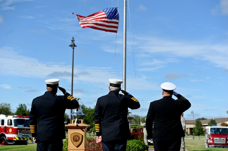 First responders salute the American flag during a Patriot Day ceremony Sept. 11, 2014, at McConnell Air Force Base, Kan. The ceremony was held in honor of the nearly 3,000 people who died during the 9/11 attacks. (U.S. Air Force photo/Airman 1st Class John Linzmeier)