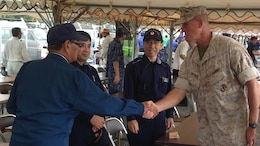 Governor Hirokazu Nakaima, left, shakes hands with Col. Christopher B. Snyder,Sept. 6 during a day of humanitarian assistance and disaster relief training on and around Miyako Island. The drills marked the first time members of the Okinawa Prefectural Government hosted a series of humanitarian assistance and disaster relief drills with full-fledged participation by the Japan Self-Defense Forces and U.S. Marines.  Nakaima is the Governor of Okinawa Prefecture and Snyder is the deputy commander with Marine Corps Base Camp Butler, Marine Corps Installations Pacific.