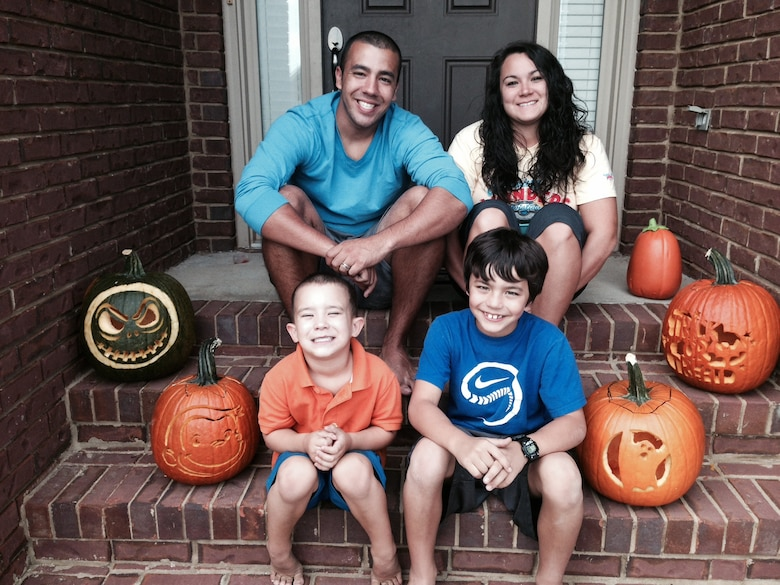 Staff Sgt. Rey Edenfield poses with his wife, Amy, and their two sons, Grayson,left, and Dawson on the front porch of their home Oct. 27, 2013. The picture was taken the day before Edenfield was involved in a motorcycle accident that resulted in his left leg being amputated six inches below the knee. Edenfield is an air traffic controller at Maxwell Air Force Base, Ala. (Courtesy photo)