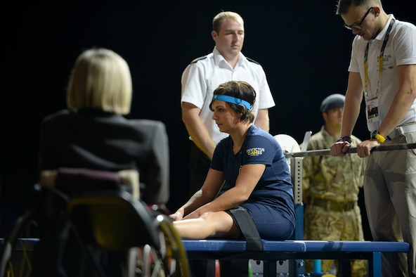 Retired Air Force Staff Sgt. Melissa Coduti concentrates as she prepares to make her lift in the women's heavyweight powerlifting competition at the Invictus Games Sept. 14, 2014, in London. The Invictus Games feature athletes competing in various Paralympic-style events, including swimming, track and field, seated volleyball, wheelchair basketball, and wheelchair rugby, among others. (U.S. Navy photo/Mass Communication Specialist 1st Class (SW) Mark Logico)