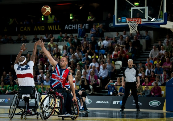 The U.S. fought hard in the wheelchair basketball finals, but fell 19-9 to Great Britain to take silver at the inaugural Invictus Games Sept. 13, in London. The Invictus Games featured athletes competing in various Paralympic-style events, including swimming, track and field, seated volleyball, wheelchair basketball, and wheelchair rugby, among others. (Courtesy photo)