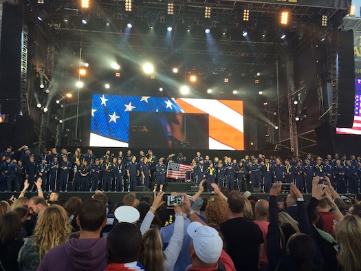 USA Team members gather to be recognized on stage Sept. 14, 2014, at the closing ceremony of the Invictus Games in London. Approximately 26,000 people were on hand for the event. The games featured athletes competing in various Paralympic-style events, including swimming, track and field, seated volleyball, wheelchair basketball, and wheelchair rugby, among others. (Courtesy photo)