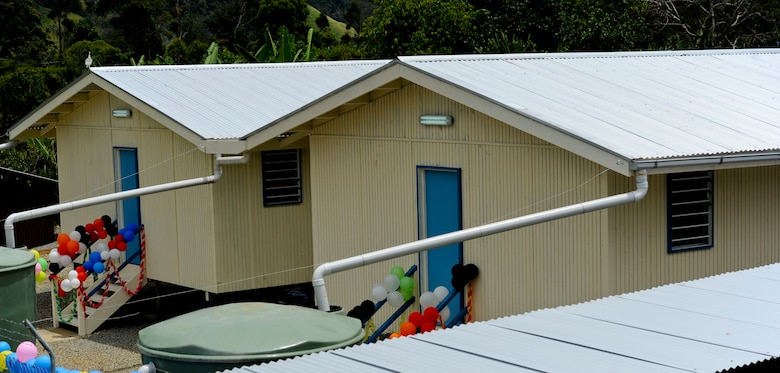Construction for Pacific Unity 14-8 began in Mount Hagen, Papua New Guinea, in August 2014. For the operation, members of the Hawaii Air National Guard's 154th Wing Civil Engineer Squadron constructed two new dormitories to be used for female students at Togoba Secondary School. PACUNITY helps cultivate common bonds and fosters goodwill between the U.S. and regional nations through multi-lateral humanitarian assistance and civil military operations.  (U.S. Air Force photo by Tech. Sgt. Terri Paden/Released)