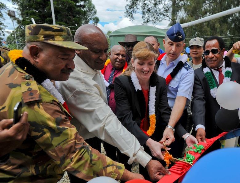 Dignitaries from the Papua New Guinea Defense Force, PNG government, U.S. Embassy and Pacific Air Forces cut the ribbon on the newly constructed girls' dormitory at Togoba Secondary School in Mount Hagen, Papua New Guinea, during the closing ceremony for Pacific Unity 14-8. PACUNITY helps cultivate common bonds and fosters goodwill between the U.S. and regional nations through multi-lateral humanitarian assistance and civil military operations.  (U.S. Air Force photo by Tech. Sgt. Terri Paden/Released)