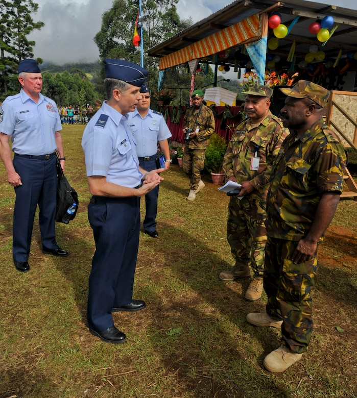 Col. Michael Addison, Pacific Air Forces deputy director for logistics, installations and mission supports, talks with his Papua New Guinea Defense Force counterparts before the closing ceremony for Pacific Unity 14-8. PACUNITY helps cultivate common bonds and fosters goodwill between the U.S. and regional nations through multi-lateral humanitarian assistance and civil military operations.  (U.S. Air Force photo by Tech. Sgt. Terri Paden/Released)