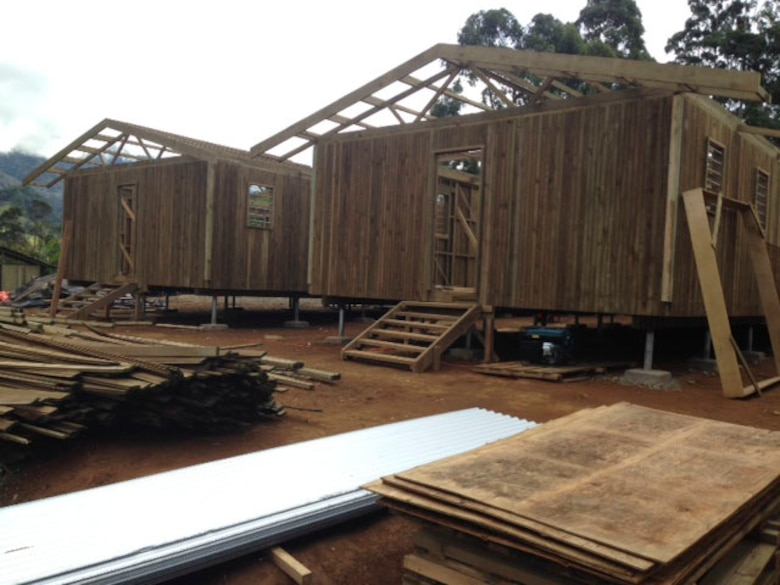 Members of the Hawaii Air National Guard 154th Civil Engineer Squadron have been working on the construction of two new dormitories to be used for female students at Togoba Secondary School in Mount Hagen, Papua New Guinea, as part of Pacific Unity 14-8. PACUNITY helps cultivate common bonds and fosters goodwill between the U.S. and regional nations through multi-lateral humanitarian assistance and civil military operations.  (U.S. Air Force photo by Airman 1st Class Jaimie Aquino/Released)