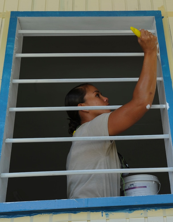 Staff Sgt. Melissa Pascua, 154th Civil Engineer Squadron emergency management journeyman deployed from the Hawaii Air National Guard, paints the window of a newly constructed dormitory as part of Pacific Unity 14-8 in Mount Hagen, Papua New Guinea.  PACUNITY helps cultivate common bonds and fosters goodwill between the U.S. and regional nations through multi-lateral humanitarian assistance and civil military operations.  (U.S. Air Force photo by Tech. Sgt. Terri Paden/Released)