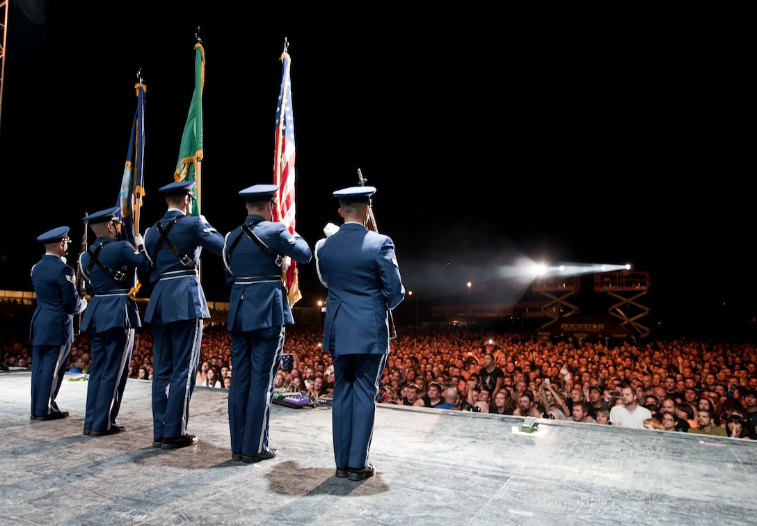 "Members from the Fairchild Air Force Base honor guard perform the colors on stage for thousands of fans during the ""Rock Hard at the Park"" concert tour Sept. 11, 2014, in Post Falls, Idaho. The concert highlighted multiple rock bands and had a special patriotic ceremony to highlight Sept. 11.  (U.S. Air Force photos by Staff Sgt. Veronica Montes/Released)"