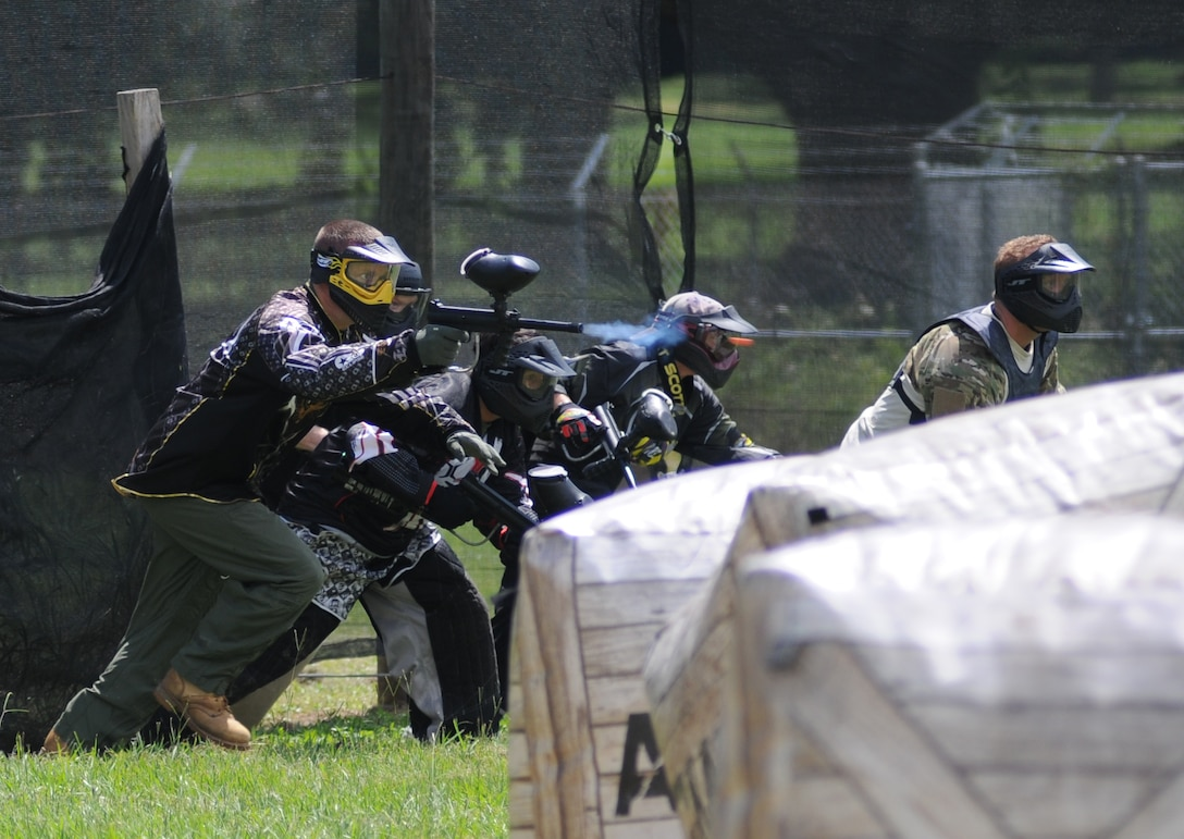 Members of the 403rd Wing team up to take part in the Fisher House Fundraiser paintball tournament Sept. 12, 2014, at the paintball complex, Keesler Air Force Base, Miss.  The event also included food, games and a dunking booth. (U.S. Air Force photo by Kemberly Groue)