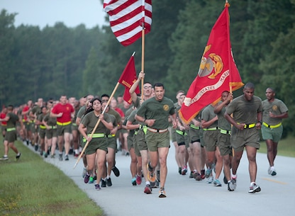 Lieutenant Colonel David E. Jones (center), Commanding Officer, Marine Corps Combat Service Support Schools (MCCSSS), leads the Marines of MCCSSS in a command run aboard Camp Johnson, N.C., Aug. 7, 2014. MCCSSS conducted a command run to promote unit cohesion, camaraderie, and physical fitness. (U.S. Marine Corps Combat Camera photo by Sergeant Mark E. Morrow/Released)