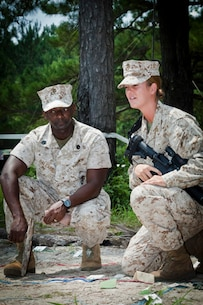 Staff Sergeant Christopher O. Ballard (left), Instructor, Logistics Officers Course (LOC), class 4-14, Logistics Operations School, Marine Corps Combat Service Support Schools, gives advice to 2nd Lieutenant Christina Rapp (right) a student, LOC, LOS, MCCSSS, class 2-14, during LOCs' field exercise that took place at landing zone Parrot aboard Camp Lejeune, N.C. Aug. 5, 2014. The training is conducted to better prepare entry level logistics officers for challenges they may be faced with in the future. (U.S. Marine Corps Combat Camera photo by Sgt. Bryce J. Burton/released)