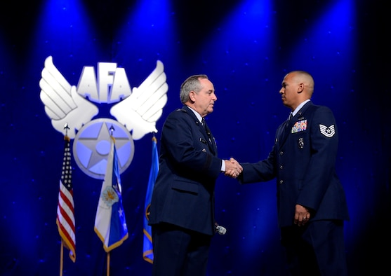 "Air Force Chief of Staff Gen. Mark A. Welsh II congratulates Tech. Sgt. Brian Williams for winning the ""American Airman"" video contest during his keynote speech at the Air Force Association's Air & Space Conference and Technology Exposition Sept. 16, 2014, in Washington, D.C. Williams currently serves with the 87th Security Forces Squadron at Joint Base McGuire-Dix-Lakehurst, N.J., his video received 1,814 votes. (U.S. Air Force photo/Scott Ash)"