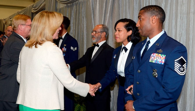 Secretary of the Air Force Deborah Lee James greets Tech. Sgt. Latoria R. Ellis, from the 502nd Contracting Squadron, 502nd Air Base Wing, Joint Base San Antonio-Lackland, Texas. Ellis is one of the 12 Outstanding Airmen of the Year for 2014 who attended a reception and awards dinner during the 2014 Air Force Association's Air & Space Conference and Technology Exposition on Sept. 15, 2014 in Washington, D.C. Other senior leaders in attendance included Chief of Staff of the Air Force General Mark A. Welsh III and his wife, Betty, and Chief Master Sgt. of the Air Force James Cody and his wife, retired Chief Master Sgt. Athena Cody. (U.S. Air Force photo/Andy Morataya)