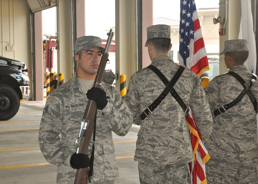Senior Airman Kenneth Del Valle-Ruiz, 51st Maintenance Group plans, scheduling and documentation journeyman, guards the flags during a base honor guard presentation, at Osan Air Base, Republic of Korea, Sept. 8, 2014.  Leadership from across Team Osan participated in the annual Mustang Immersion to develop a better understanding of what Osan Airmen are able to bring to the fight.  (U.S. Air Force photo/Capt. Robert Howard)