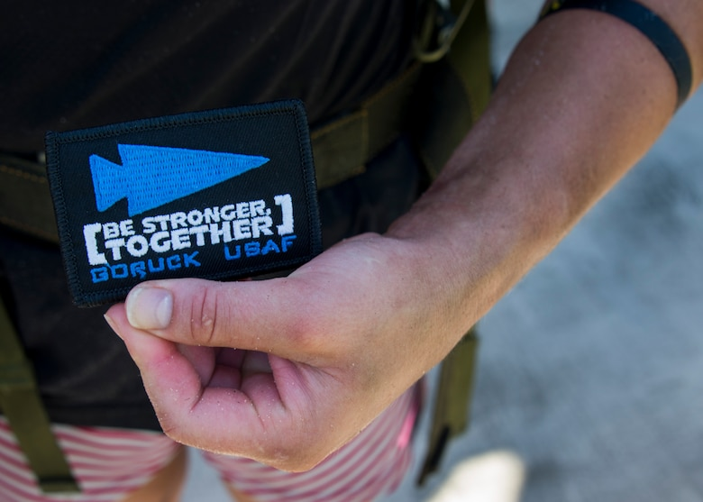 Justine Dechiara receives her patch for completing the GORUCK Cohesion Challenge Sept. 11, at Eglin Air Force Base, Fla.  This elite team-building event, led by a Special Forces veteran, featured military inspired challenges and missions.  Only 24 out of the original 27 completed all obstacles.  Eglin is the fifth base to complete the Team Cohesion Challenge, which is modeled after special operations training.  (U.S. Air Force photo/Tech. Sgt. Jasmin Taylor)