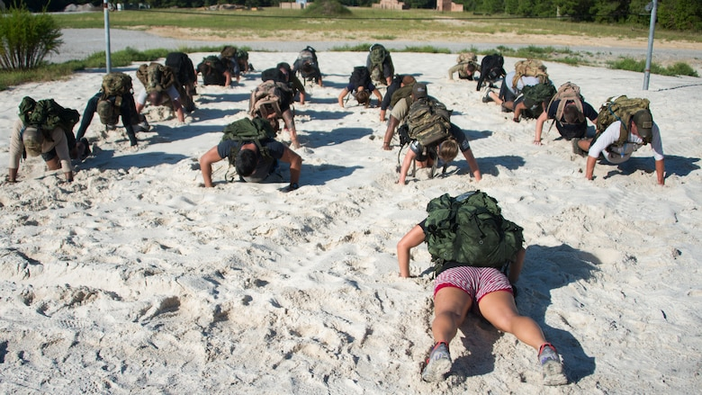 The team leader leads the group in push-ups during the GORUCK Cohesion Challenge Sept. 11, at Eglin Air Force Base, Fla.  This elite team-building event, led by a Special Forces veteran, featured military inspired challenges and missions.  Only 24 out of the original 27 completed all obstacles.  Eglin is the fifth base to complete the Team Cohesion Challenge, which is modeled after special operations training.  (U.S. Air Force photo/Tech. Sgt. Jasmin Taylor)