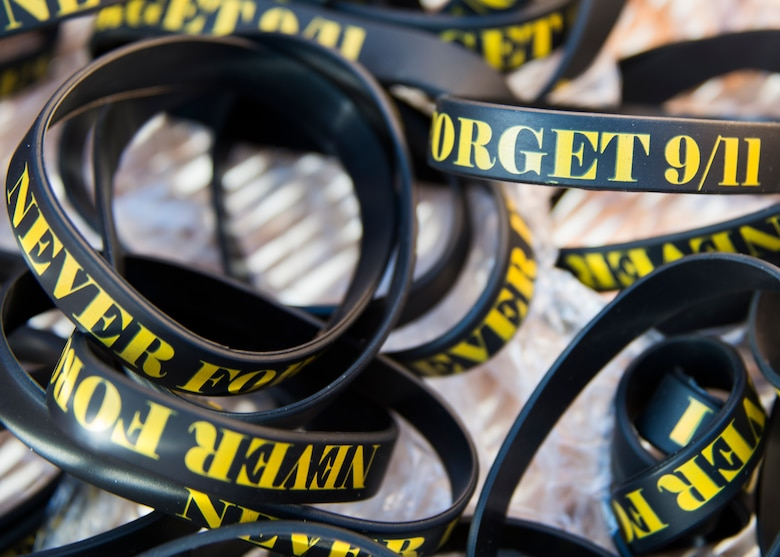 """A basket of rubber bracelets with the saying """"Never Forget 911"""" were passed out before the GORUCK Cohesion Challenge Sept. 11, at Eglin Air Force Base, Fla.  This elite team-building event, led by a Special Forces veteran, featured military inspired challenges and missions.  Only 24 out of the original 27 completed all obstacles.  Eglin is the fifth base to complete the Team Cohesion Challenge, which is modeled after special operations training.  (U.S. Air Force photo/Tech. Sgt. Jasmin Taylor)"""