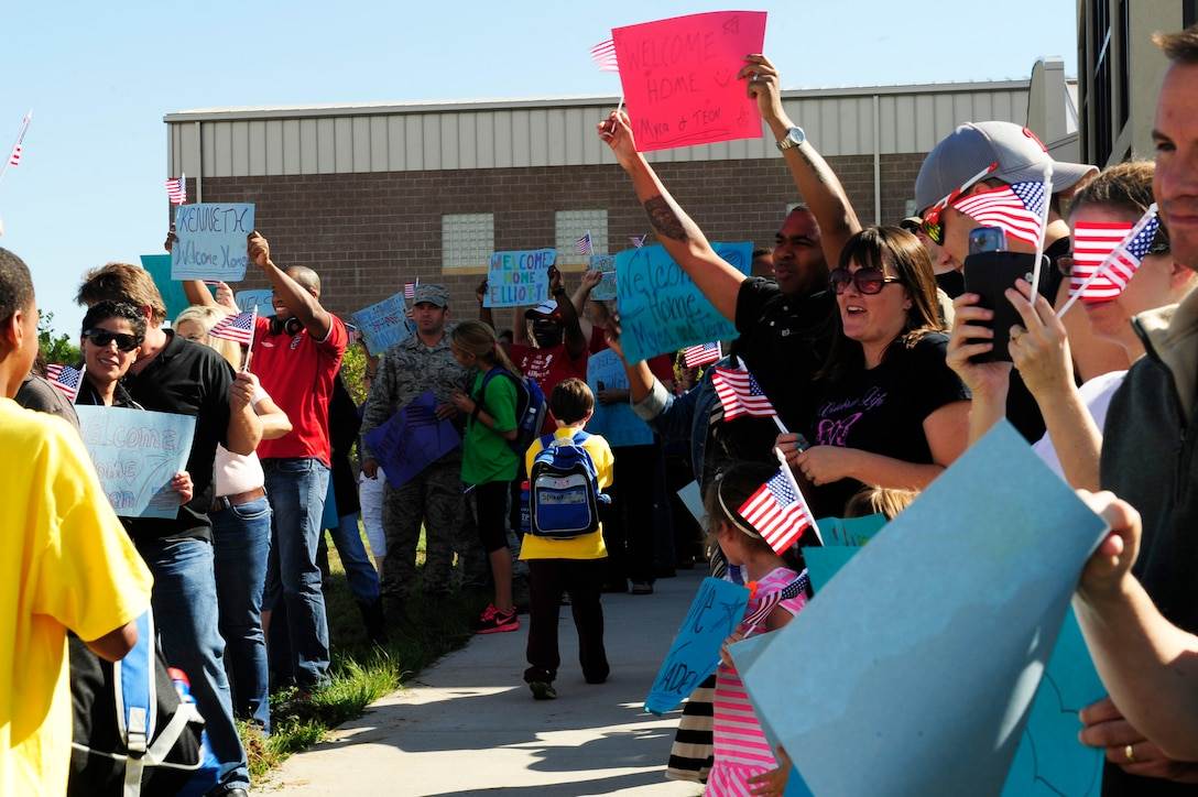 """Friends and family welcome home the """"troops"""" of Operation Future Forces at the end of a mock deployment Sept. 13, 2014, at the youth center on Buckley Air Force Base, Colo. During OFF, children were given the chance to experience what a military member endures from """"Basic Military Training"""" to a mock deployment. (U.S. Air Force photo by Airman 1st Class Samantha Saulsbury/Released)"""