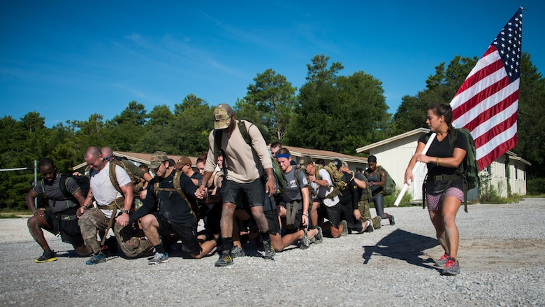 Members perform team lunges as part of the GORUCK Cohesion Challenge Sept. 11, at Eglin Air Force Base, Fla.  This elite team-building event, led by a Special Forces veteran, featured military inspired challenges and missions.  Only 24 out of the original 27 completed all obstacles.  Eglin is the fifth base to complete the Team Cohesion Challenge.  (U.S. Air Force photo/Tech. Sgt. Jasmin Taylor)