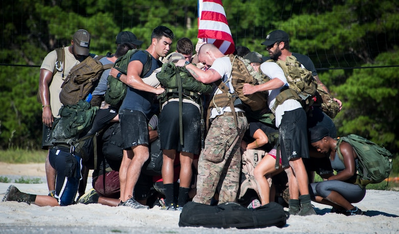Members break for a moment of silence to remember the fallen during the GORUCK Cohesion Challenge Sept. 11, at Eglin Air Force Base, Fla.  This elite team-building event, led by a Special Forces veteran, featured military inspired challenges and missions.  Only 24 out of the original 27 completed all obstacles.  Eglin is the fifth base to complete the Team Cohesion Challenge.  (U.S. Air Force photo/Tech. Sgt. Jasmin Taylor)