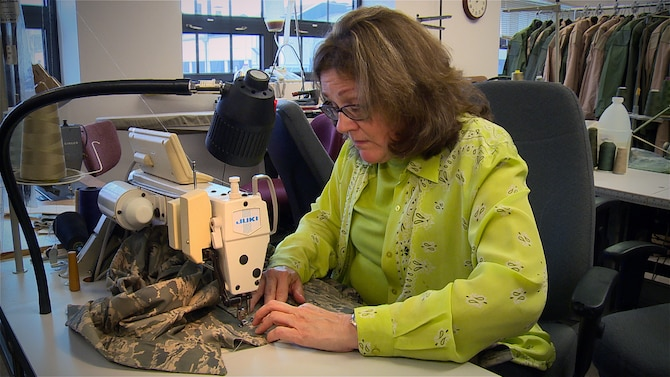 Debra Klensch sews pockets on an Airman Battle Uniform. Klensch is a clothing designer in the Air Force Uniform Office at Wright-Patterson Air Force Base, Ohio. The AFUO is an integrated product team of designers and engineers within the Human Systems Division here that works together to develop patterns, create prototypes, and manage fit and wear tests for more than 520 individual items. (U.S. Air Force photo/Matthew Clouse)