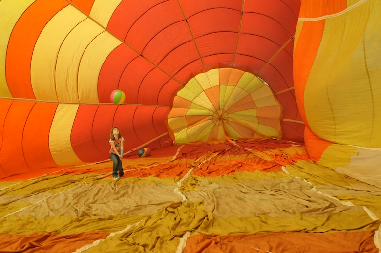 Augusta Cooper, 7, plays in a hot air balloon during the 109th Airlift Wing's Family Day at Stratton Air National Guard Base, N.Y., on Sept. 14, 2014. About 3,000 people attended the event which included food, music, games, static displays and much more for Airmen and their families. (U.S. Air National Guard photo by Master Sgt. William Gizara/Released)