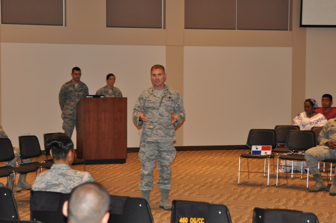 Col. Darren Buck, 460th Space Wing individual mobilization augmentee to the commander, speaks during the Hispanic Heritage Month kickoff that featured local guest speakers, dancing, music and food Sept. 15, 2014, at the Leadership Development Center on Buckley Air Force Base, Colo. The month-long commemoration runs through Oct. 15, and will include different activities that honor Hispanic Americans who have positively enriched and influenced the nation. (U. S. Air Force photo by Tech. Sgt. Rob Hazelett/Released)