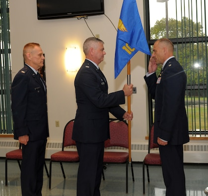 Lt. Col. Jeffrey Hedges (right) assumes command of the 109th Mission Support Group from Col. Shawn Clouthier (center), 109th Airlift Wing commander, during a change of command ceremony Sept. 13, 2014, at Stratton Air National Guard Base, N.Y. Col. Walter Wintsch (left) relinquished command during the ceremony. Hedges served as the 109th Logistics Readiness Squadron commander before taking the position as MSG commander. (U.S. Air National Guard photo by Master Sgt. William Gizara/Released)