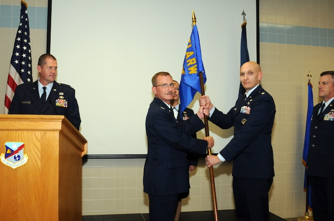 Lt. Col. John Richardson assumes command of the 151st Force Support Squadron from outgoing commander Lt. Col. Mark Roberts during a change of command ceremony held at the Utah Air National Guard Base dining facility on Sept. 14, 2014. (Utah Air National Guard Photo by Staff Sgt. Annie Edwards/RELEASED)