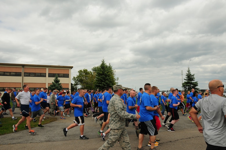 107th unit members participate in the 5K Sexual Assault Prevention and Response program run at the Niagara Falls Reserve Station on Sept, 13, 2014. (U.S. Air National Guard Photo/Senior Airman Kayla Blake/Released)
