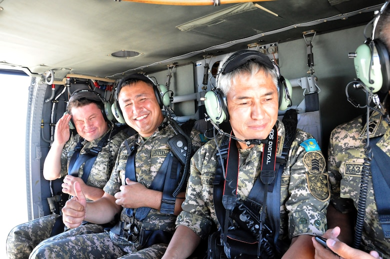 Noncommissioned officers from the Armed Forces of the Republic of Kazakhstan enjoy a UH-60 Black Hawk flight over Arizona, Sep. 11, 2014. A delegation of Kazakhs met with Arizona Army and Air Guard members to discuss the varied roles of enlisted members in military aviation. Kazakhstan and the Arizona National Guard have participated together in the National Guard Bureau's State Partnership Program since 1993. (National Guard photo by Spc. Wes Parrell)
