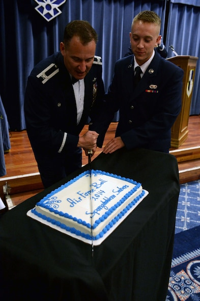U.S. Air Force Col. Pete Bilodeau, left, 52nd Fighter Wing commander, and U.S. Air Force Airman Basic Trevor Hume Wolanske, a vehicle operator from the 52nd Logistics Readiness Squadron, cut the cake in commemoration of the Air Force's 67th birthday during the Air Force Ball in Club Eifel at Spangdahlem Air Base, Germany, Sept. 13, 2014. Bilodeau and Hume Wolanske, as both the installation's most senior-ranking and junior-ranking Airmen, respectively, cut the cake per Air Force tradition. (U.S. Air Force photo by Airman 1st Class Timothy Kim/Released)
