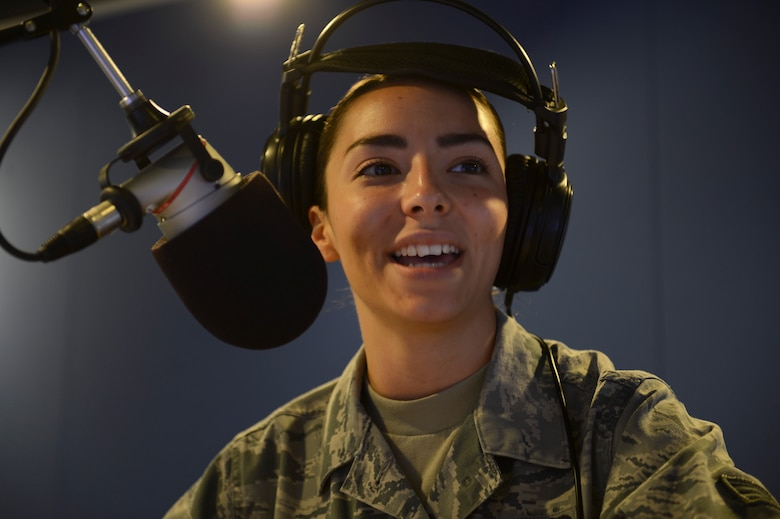 Senior Airman Courtney Graffius, American Forces Network Kaiserslautern broadcast journalist, DJs a radio morning show on Vogelweh Military Complex, Sept. 10, 2014. AFN Kaiserslautern consists of Airmen and soldiers working together to inform and update a multi-service community on the things happening around them. (U.S. Air Force photo/Airman 1st Class Michael Stuart)