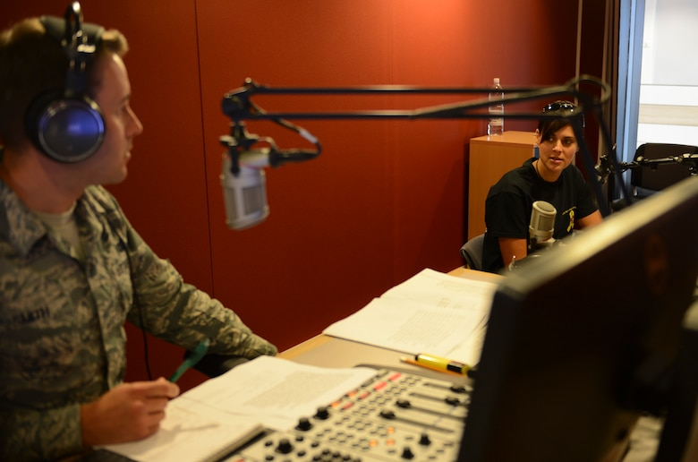 Senior Airman Eli Smith, American Forces Network Kaiserslautern broadcast journalist, interviews Sarah Jane Phillips, Army Substance Abuse Program prevention coordinator, during a radio morning show on Vogelweh Military Complex, Sept. 10, 2014. AFN Kaiserslautern consists of Airmen and soldiers working together to inform and update a multi-service community on the things happening around them. (U.S. Air Force photo/Airman 1st Class Michael Stuart)