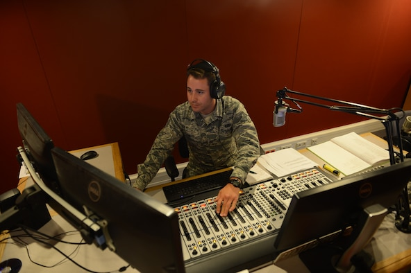 Senior Airman Eli Smith, American Forces Network Kaiserslautern broadcast journalist, DJs a radio morning show on Vogelweh Military Complex, Sept. 10, 2014. The American Forces Network, Kaiserslautern, has been providing service to military members since 1954 while bringing with them a taste of home. (U.S. Air Force photo/Airman 1st Class Michael Stuart)