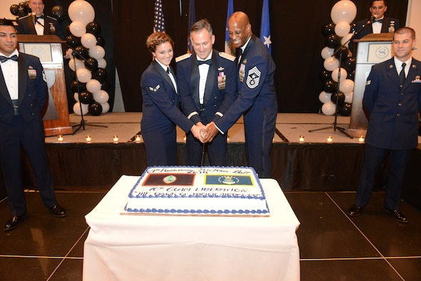 Airman 1st Class Hannah Walsh Brig. Gen. Andrew J. Toth is Commander, 36th Wing, and Guam Chief Master Sgt. Michael A. McMillan,36th Wing, Command Chief, cut the Air Force birthday cake at the 67th Annual Air Force Ball Sept 13, 2014, at The Sheraton Hotel in Tumon, Guam. Cake cutting rituals feature the oldest Airman present cutting the cake with the youngest airman present. (U.S. Air Force Photo by Airman 1st Class Adarius Petty/Released)