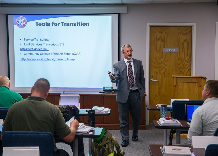 Kevin Hawks, transition assistance counselor, leads a class in the Airman and Family Readiness Center, Sept. 15, 2014, at Joint Base Charleston, S.C. The A&FRC on the Air Base, and the FFSC at the Weapons Station, both provide programs to service members from all military branches; active duty, guardsmen or reservists, along with their families and retirees. They also offer office hours at the Naval Nuclear Power Training Command's Rickover Center to make it easier for Sailors attending school to utilize their services. (U.S. Air Force photo/Staff Sgt. William O'Brien)