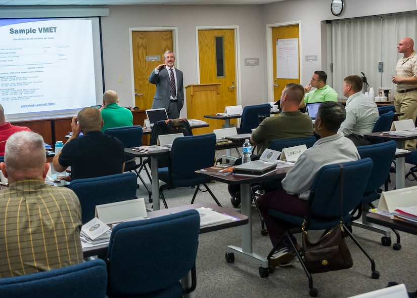 Kevin Hawks, transition assistance counselor, leads a class in the Airman and Family Readiness Center, Sept. 15, 2014 at Joint Base Charleston, S.C. The A&FRC and Fleet and Family Support Center provide service members and their families the tools, training and guidance they need to navigate the unique challenges of military service. (U.S. Air Force photo/Staff Sgt. William O'Brien)