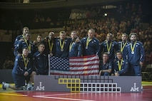 The USA Team poses for a picture as they placed second in the sitting volleyball finals at the Invictus Games Sept. 14, 2014, in London. Great Britain defeated the U.S. in a best-out-of-five match. The Invictus Games featured athletes competing in various Paralympic-style events, including swimming, track and field, seated volleyball, wheelchair basketball, and wheelchair rugby, among others. (U.S. Navy photo/Mass Communication Specialist 1st Class (SW) Mark Logico)